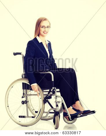 Beautiful caucasain business woman sitting on wheelchair.