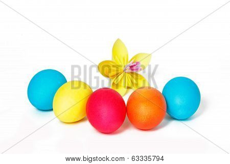 Many Easter eggs and colored paper flower