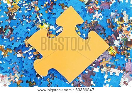 Big Yellow Piece On Pile Of Disassembled Puzzles