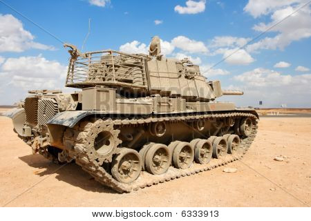 Old Israeli Magach tank near the military base in the desert