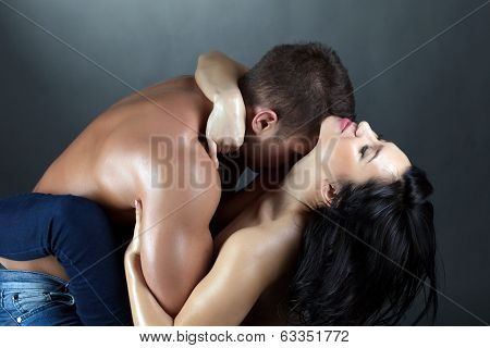 Portrait of passionate topless partners embracing