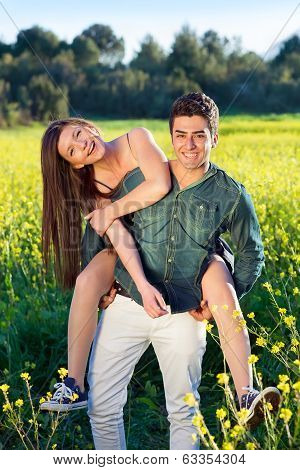 Two Young Lovers In A Field Of Yellow Rapeseed