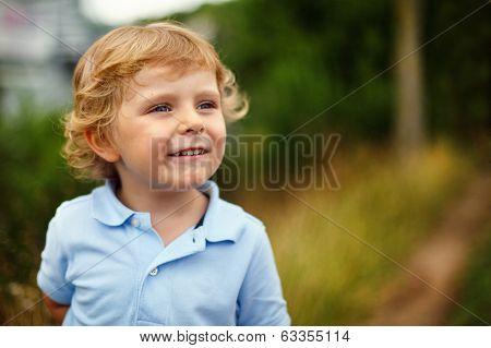 Preschool Boy Walking On A Country Road