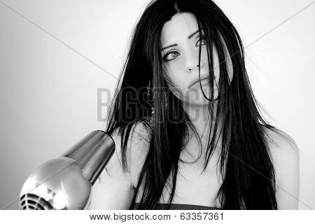 Beautiful Woman Tired Of Drying Long Hair