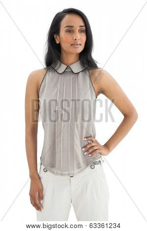 Serious young woman looking away over white background