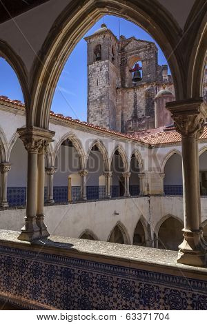 Tomar, Portugal - July 18, 2013: Washing Cloister and church bell tower in the Templar Convent of Christ in Tomar, Portugal. UNESCO World Heritage
