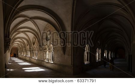Alcobaca, Portugal - July 17, 2013: Dom Dinis cloister in Alcobaca Monastery. Cistercian Religious Order. Masterpiece of the Gothic. Unesco World Heritage, Portugal