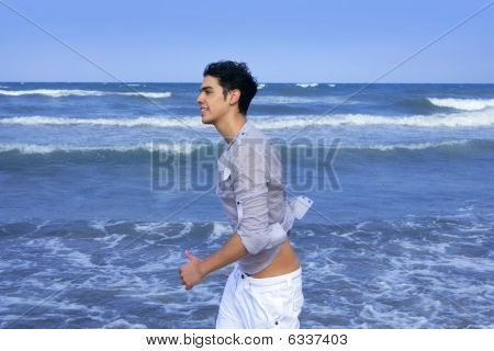 Handsome Young Man On The Blue Ocean Beach