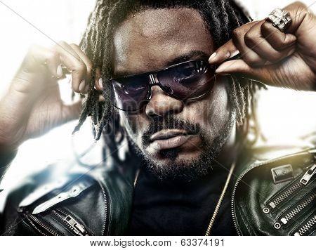black man with cool sunglasses posing