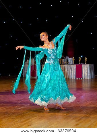 Female dancer performs at dance championship. Slow waltz dance.