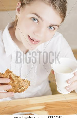 Portrait Of Teenager Girl Eating Morning Breakfast
