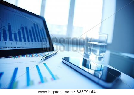 Image of document, pen, cellular phone, glass of water and touchpad on workplace