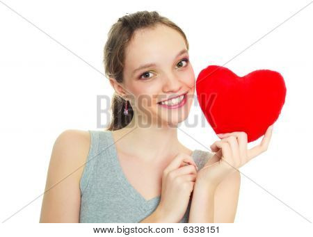 Girl With A Heart-shaped Pillow