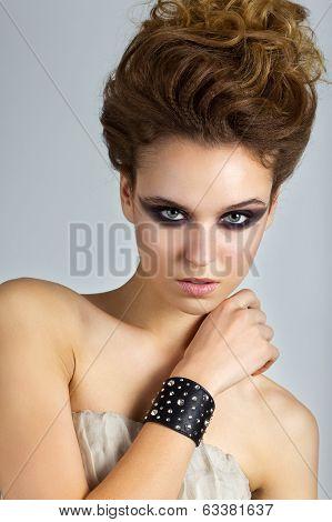 Beautiful woman with stage make-up. Fashion photo