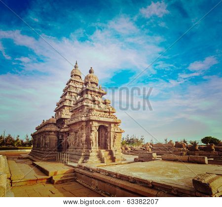 Vintage retro hipster style travel image of famous Tamil Nadu landmark - Shore temple, world  heritage site in  Mahabalipuram, Tamil Nadu, India
