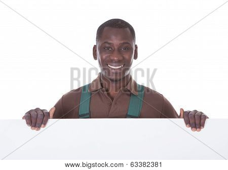 Gardener Holding Bill Board