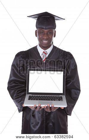 Graduation Man Showing Laptop