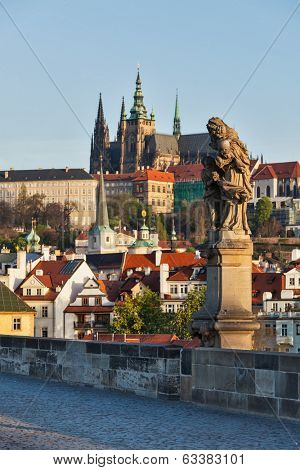Statue on Charles Brigde with St. Vitus Cathedral in background in Prague