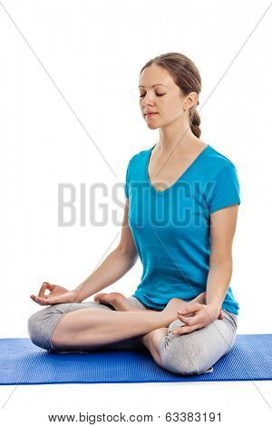 Yoga - young beautiful woman yoga instructor doing Lotus Position (padmasana with chin mudra) asana exercise - cross-legged sitting asana for meditation - isolated on white background