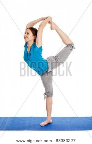 Yoga - young beautiful woman yoga instructor doing Lord of the Dance Pose (Natarajasana) asana in ashtanga vinyasa style exercise isolated on white background