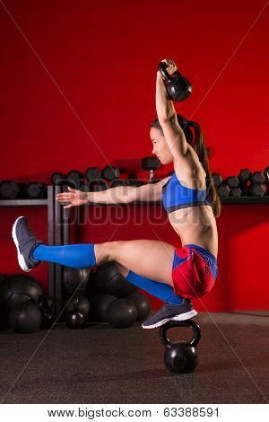 kettlebell woman pistol squat workout balance in red gym