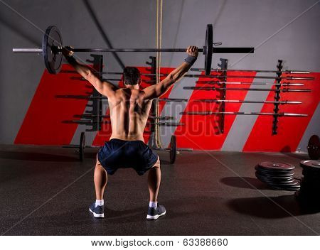 barbell weight lifting man rear view back workout exercise at gym box