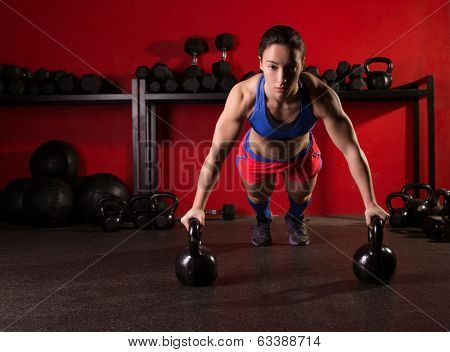 Kettlebells push-up woman strength pushup exercise workout at gym