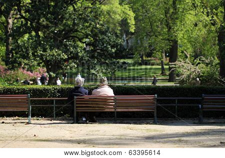 Retired couple on a park bench