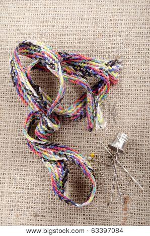 Mending Kit And Needle On Jute