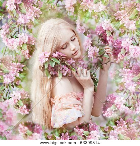 Beautiful woman with flowering tree. Beauty young girl in garden.