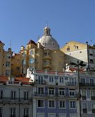 stock photo of cupola  - View on the old Lisbon city with houses and church cupola - JPG