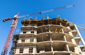 Samara, Russia - April 13, 2014:tall Building Under Construction With Crane Against A Blue Sky