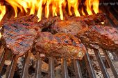 picture of flame-grilled  - Beef Steak on the BBQ Grill with flames - JPG
