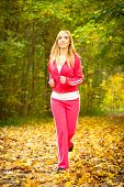 Blonde Girl Young Woman Running Jogging In Autumn Fall Forest Park