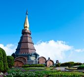 The Modern Thai Style Pagoda With Blue Sky And Garden In Thailand