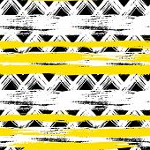 stock photo of primite  - Vector seamless ethnic pattern with bold zigzag brushstrokes and stripes in bright colors can be used for print - JPG