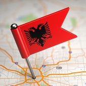 pic of albania  - Small Flag of Republic of Albania Sticked in the Map Background with Selective Focus - JPG