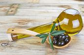 stock photo of kalamata olives  - Smart bottle of olive oil and wooden spoon with black olives - JPG