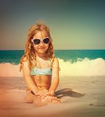 Child on the beach. Girl at vacations on sea