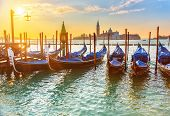 stock photo of gondola  - Venetian gondolas at sunrise - JPG