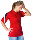 Disappointed football fan in red on white background