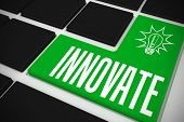 The word innovate and idea and innovation graphic on black keyboard with green key