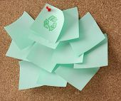Recycle sign on green sheet of paper