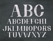 picture of letter b  - A chalk font on a dark black board background - JPG
