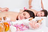 foto of reflexology  - Relaxed Young Couple Receiving An Acupuncture Treatment In A Spa Center - JPG
