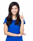 Happy Asian woman pointing up with her finger