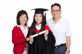 Happy family with graduate daughter
