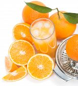 pic of juicer  - Cold orange juice in the glass with ice cubes and fresh pieces of oranges Focus is on a juice surface top view - JPG