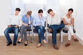 stock photo of sleep  - Young Group Of People Sleeping On Chair In A Waiting Room - JPG
