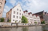 stock photo of polonia  - Old and renovated buildings over Motlava River in Gdansk Poland - JPG